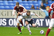 Bolton Wanderers Mark Beevers (5) and Northampton Towns Michael Smith (24) during the EFL Sky Bet League 1 match between Bolton Wanderers and Northampton Town at the Macron Stadium, Bolton, England on 18 March 2017. Photo by Craig Galloway.