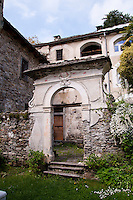 Ticino, Southern Switzerland.  Arched entrance to an old monastery in Verdasio.