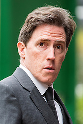 © Licensed to London News Pictures. 18/04/2016. Shirley, UK.  Rob Brydon arrives for the funeral of comedian, actor, writer Ronnie Corbett, held at St John the Evangelist Church in Shirley near Croydon. Corbett, who was most famous for his comedy sketch show  The Two Ronnies, performed with the late Ronnie Barker, died at the age of 85. Photo credit: Ben Cawthra/LNP