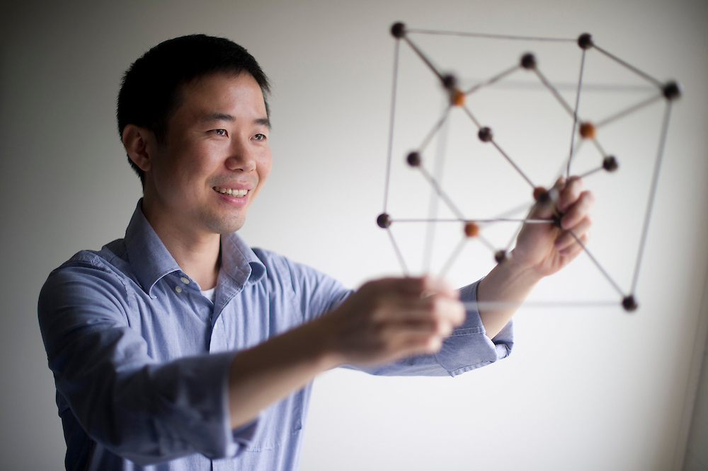 July 29, 2013 - Yongmin Liu, Assistant Professor of mechanical and industrial engineering and electrical and computer engineering, is seen holding a model of a silicon molecule.  Liu and his colleagues at Penn State have developed the first microfluidic optical device that will enable multifunctional materials for ultra fast, ultra small technologies.