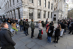 Mourners queue around the block to leave flowers and sign the book of condolence at  South Africa House in London, Friday, 6th December 2013, following the death Nelson Mandela, Picture by Stephen Lock / i-Images