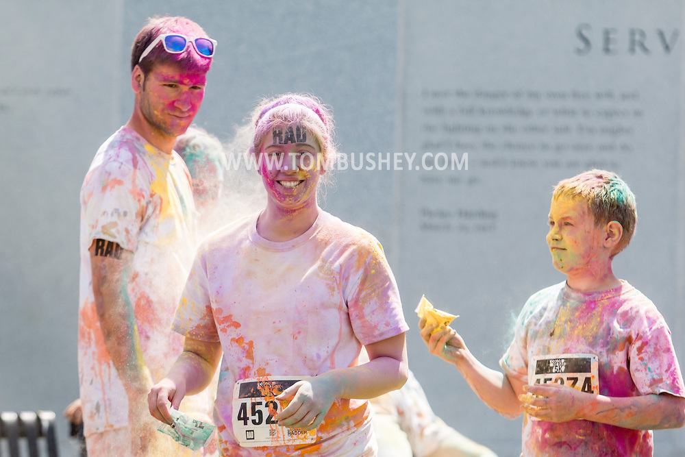 Scranton, Pa. - People are covered in colorful powder after the Color Me Rad 5K color run on May 24, 2015.