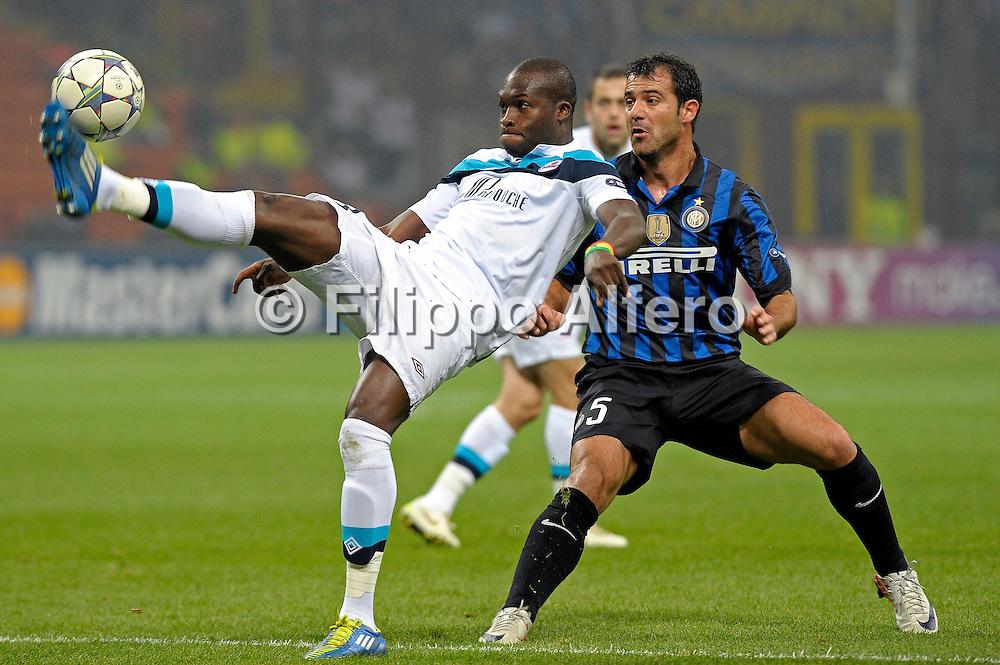 &copy; Filippo Alfero<br /> Inter vs Lille - Champions League 2011 / 2012<br /> Milano, 02/11/2011<br /> sport calcio<br /> Nella foto: Dejan Stankovic e Moussa Sow