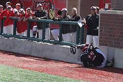 26 April 2015:  Jean Ramirez runs and then slides to the opening of the dugout chasing a fly foul ball during an NCAA Division I Baseball game between the Missouri State Bears and the Illinois State Redbirds in Duffy Bass Field, Normal IL