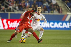 March 1, 2018 - Harrison, New Jersey, United States - Club Deportivo Olimpia Midfielder JAVIER PORTILLO (25) fights for the ball against New York Red Bulls defender MARC RZATKOWSKI (90) during the CONCACAF Champions league match at Red Bull Arena in Harrison, NJ.  NY Red Bulls defeat CD Olimpia 2-0  (Credit Image: © Mark Smith via ZUMA Wire)