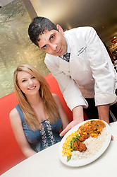 Perween Cooking Solutions 500,000 curry served to Student Charlotte Jackson by Chef Hallam food production Manager Gagan Kapoor at Monday lunch time $th April 2011..4 April 2011.Images © Paul David Drabble