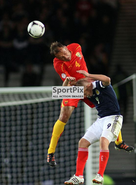 Kenny Miller scotland takes a sore one from Nikolche Noveski macedonia in the .FIFA World Cup Qualifier scotland v macedonia, hampden stadium, glasgow .Kevin McGlynn(c)  | StockPix.eu.