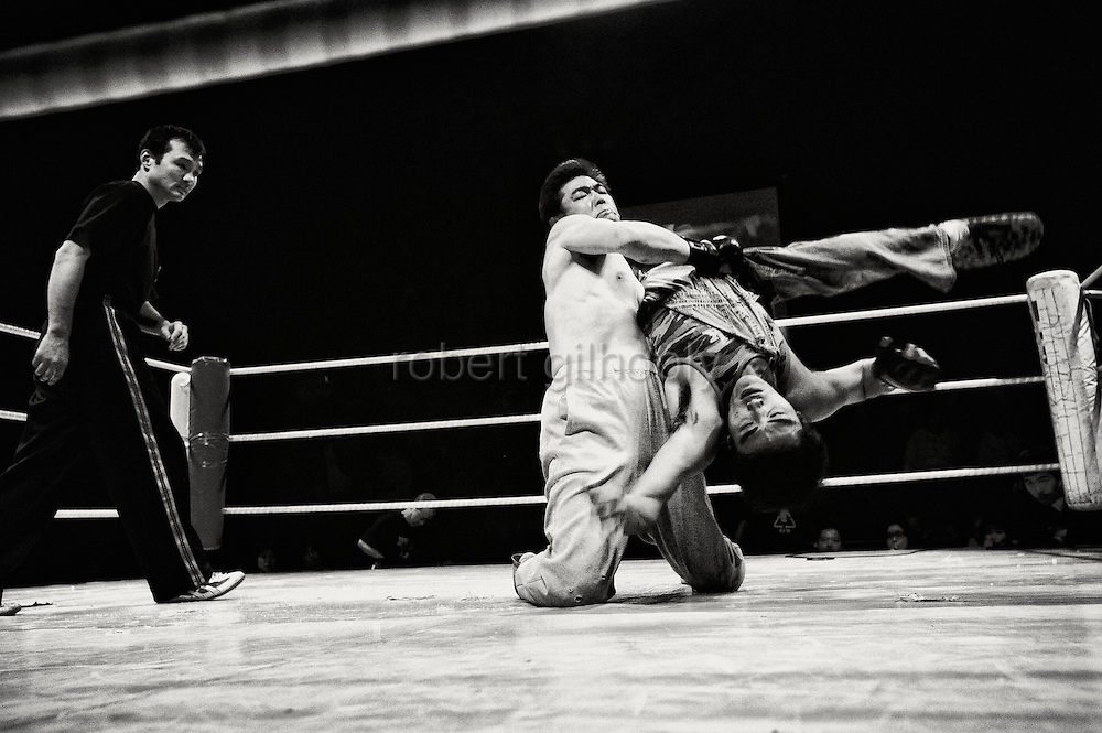 Wrestlers do battle during a bout at Doglegs, an event for wrestlers with physical and mental handicaps in Tokyo, Japan.