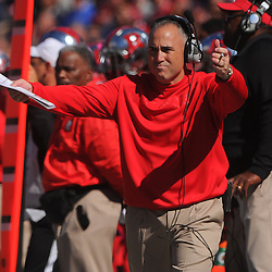 Oct 13, 2012: Rutgers Scarlet Knights head coach Kyle Flood waves for the student section to get loud on a third down play during NCAA Big East college football action between the Rutgers Scarlet Knights and Syracuse Orange at High Point Solutions Stadium in Piscataway, N.J.