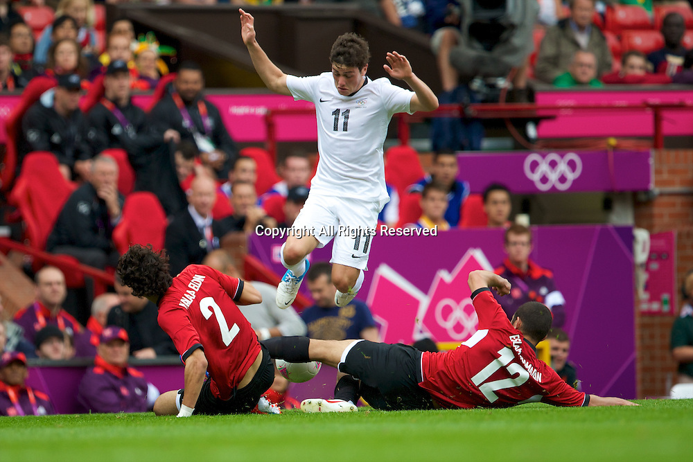 29.07.2012 Manchester, England. New Zealand midfielder Marco Rojas, Egypt goalkeeper Ahmed El-Shenawy and Egypt defender Islam Ramadan in action during the first round group C mens match between Egypt and New Zealand.