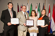 Scott Dick of Corn, Oklahoma, and Amanda Higgins of Canute, Oklahoma, receive an Oklahoma State University Leon Williams Scholarship from Leon and Linda Williams at the university's recent College of Agricultural Sciences and Natural Resources Scholarships and Awards Banquet. The scholarship is part of more than $1.4 million in scholarships and awards presented to CASNR students for the 2016-2017 academic year. (Photo by Todd Johnson)