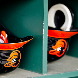 March 20, 2012; Sarasota, FL, USA; Baltimore Orioles batting helmets in the dugout for a spring training game against the Philadelphia Phillies at Ed Smith Stadium.  Mandatory Credit: Derick E. Hingle-US PRESSWIRE
