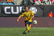 Arsenal defender Shkodran Mustafi (20) passes the ball in a game against Fiorentina during an International Champions Cup game, Saturday, July 20, 2010, in Charlotte, NC. Arsenal defeated Fiorentina 3-0. (Brian Villanueva/Image of Sport)