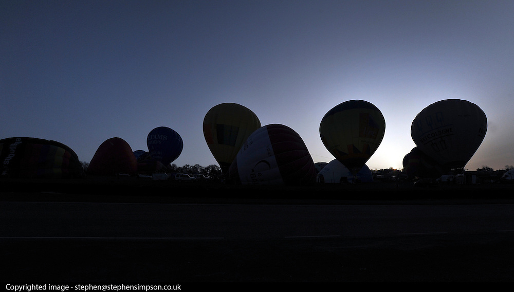 London News pictures. 07/04/2011. CANTERBURY: Balloons wait for the dawn take off slot. Approximately 50 hot air balloons from across the UK and Europe take advantage of the weather window and take off from Lydden Hill Race Circuit, Wootton, Kent, to fly across the English Channel marking the largest ever group of balloons to attempt the crossing. The participants  have been waiting since October for the event to happen. Picture credit should read Stephen Simpson/LNP
