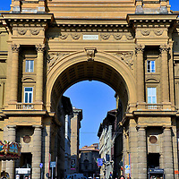 """Arcone Triumphal Arch at Piazza della Repubblica in Florence, Italy<br /> Piazza della Repubblica has a long history. It began as a Roman forum before evolving into the commercial heart of Firenze. Then the area deteriorated into a ghetto where minorities were segregated. After Florence became the capital of the Kingdom of Italy in 1865, the seediness was swept aside as medieval landmarks were demolished during a massive urbanization project. The Arcone Triumphal Arch was built in 1895 to celebrate the transformation. Its inscription reads: """"The ancient center of the city restored from age-old squalor to new life."""" Republic Square is now the home of high-end hotels, stores and popular cafes."""