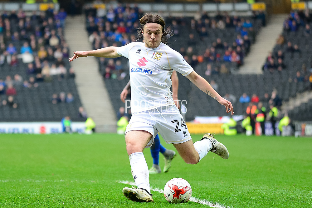 Milton Keynes Dons defender Ben Tilney (24) gets in a cross during the EFL Sky Bet League 1 match between Milton Keynes Dons and Rochdale at stadium:mk, Milton Keynes, England on 11 March 2017. Photo by Dennis Goodwin.