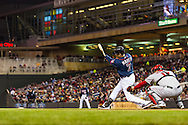Joe Mauer #7 of the Minnesota Twins connects for a single against the Los Angeles Angels on April 16, 2013 at Target Field in Minneapolis, Minnesota.  The Twins defeated the Angels 8 to 6.  Photo: Ben Krause