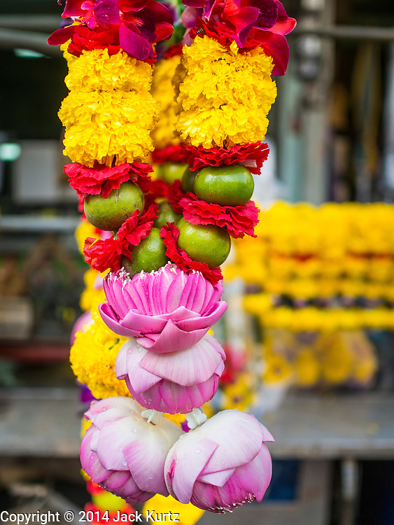 17 AUGUST 2014 - BANGKOK, THAILAND:   Flower garlands for sale in front of a Hindu temple in Bangkok during the celebration of Krishna Janmashtami. Krishna Janmashtami is the annual celebration of the birth of the Hindu deity Krishna, the eighth avatar of the Hindu god Vishnu. It is celebrated by Hindus in Thailand. There are about 53,000 Hindus in Thailand, most originally from India, but many Hindu deities are highly revered by Thai Buddhists and Hindu holy days are observed by many Thai Buddhists.      PHOTO BY JACK KURTZ