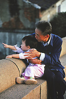Grandfather and his grandson in China