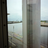A security camera trained on the Lowry art gallery in the Salford Quay development at the western end of the Manchester Ship Canal which links in with the river Mersey to connect with the Irish Sea. The Mersey is a river in north west England which stretches for 70 miles (112 km) from Stockport, Greater Manchester, ending at Liverpool Bay, Merseyside. For centuries, it formed part of the ancient county divide between Lancashire and Cheshire.