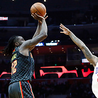 08 January 2018: Atlanta Hawks forward Taurean Prince (12) takes a jump shot over LA Clippers guard Lou Williams (23) during the LA Clippers 108-107 victory over the Atlanta Hawks, at the Staples Center, Los Angeles, California, USA.