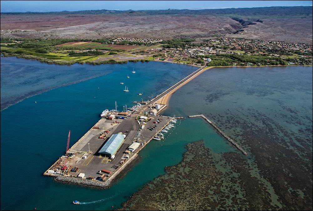 Kaunakakai Wharf with Kaunakakai in background. Molokai, Hawaii