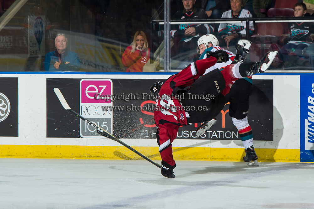 KELOWNA, CANADA - JANUARY 26: Lassi Thomson #2 of the Kelowna Rockets checks Dawson Holt #19 of the Vancouver Giants during second period  on January 26, 2019 at Prospera Place in Kelowna, British Columbia, Canada.  (Photo by Marissa Baecker/Shoot the Breeze)
