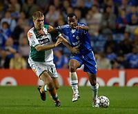 Photo: Daniel Hambury.<br />Chelsea v Werder Bremen. UEFA Champions League, Group A. 12/09/2006.<br />Chelsea's Ashley Cole battles with Bremen's Ivan Klasnic.