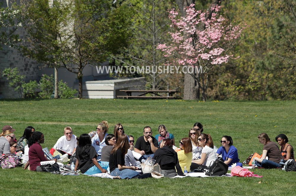 Middletown, New York - Students attend a class held outside on the college green at SUNY Orange on April 19, 2012.