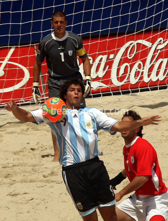 Football - FIFA Beach Soccer World Cup 2006 - Quarter Final - ARG X URU  - Rio de Janeiro - Brazil 09/11/2006<br />Facundo Minici jumps for the ball during the match - Event Title Board Mandatory Credit: FIFA / Ricardo Moraes