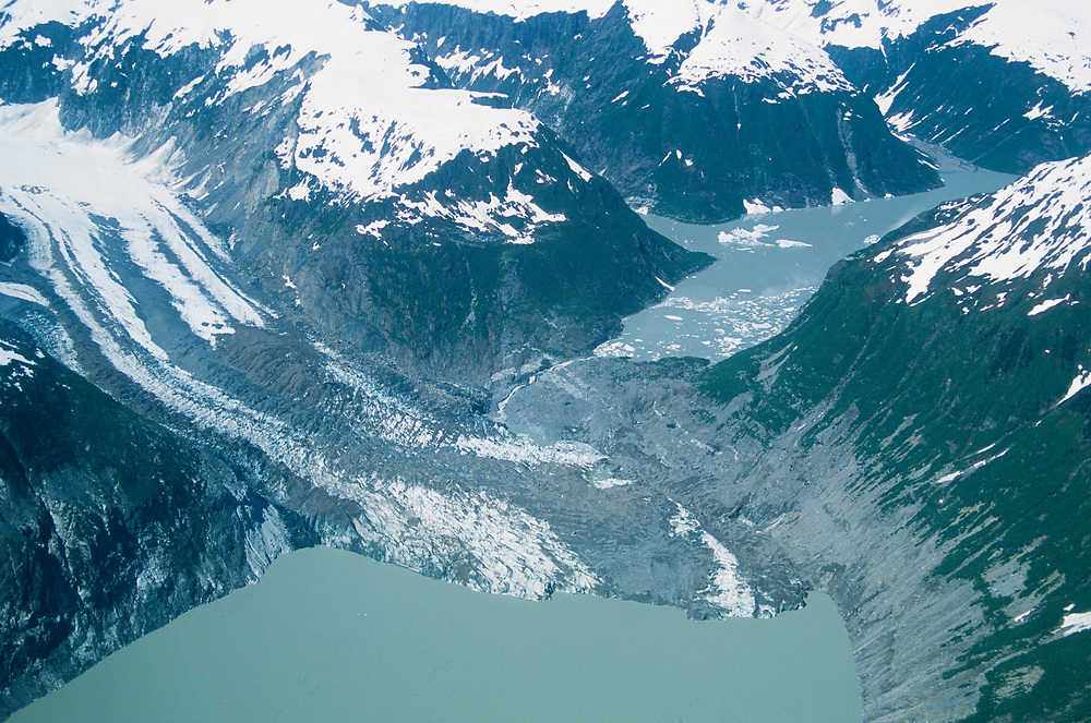 Alaska. Glacier Bay NP. Fairweather Range. A glacier flowing into a lake dams up a valley, creating another Lake.