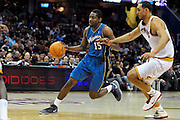 April 13, 2011; Cleveland, OH, USA; Washington Wizards shooting guard Jordan Crawford (15) drives past Cleveland Cavaliers center Ryan Hollins (5) during the third quarter at Quicken Loans Arena. The Cavaliers beat the Wizards 100-93. Mandatory Credit: Jason Miller-US PRESSWIRE