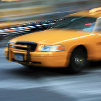 Yellow Taxi in motion, Manhattan, New York, USA