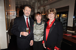 Left to right, TIM HERRING, JULIE HODGES who Julie's was named after and CATHY HERRING  at a party to celebrate the 40th anniversary of Julie's Bar & Restaurant, 135 Portland Road, London W11 on 18th November 2010.