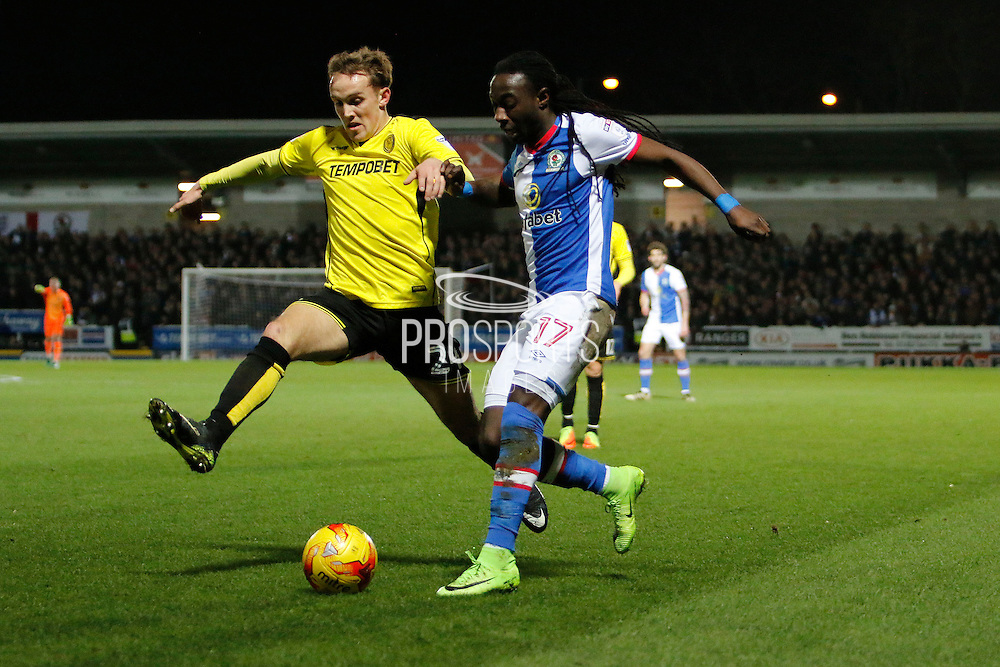 Burton Albion midfielder Lasse Vigen Christensen (24) and Blackburn Rovers striker Marvin Emnes (17)   during the EFL Sky Bet Championship match between Burton Albion and Blackburn Rovers at the Pirelli Stadium, Burton upon Trent, England on 24 February 2017. Photo by Richard Holmes.