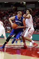 31 December 2014:  Jake Kitchell storms the paint while guarded by Reggie Lynch during an NCAA Division 1 Missouri Valley Conference (MVC) men's basketball game between the Indiana State Sycamores beat the Illinois State Redbirds 63-61 at Redbird Arena in Normal Illinois