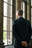 Businessman Looking Out Window