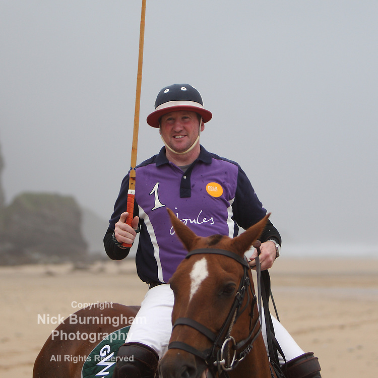Watergate Bay, Newquay, Cornwall, UK - JUNE 2, 2015: Professional Polo players Andy Burgess riding Tonka and Daniel Loe riding La Sophia practise on the beach at Watergate Bay. The practise session took place ahead of the main event - GWR Polo on the Beach, which will be held from Friday 26 to Sunday 28 June 2015. The event is in its ninth year.