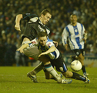 Photo: Aidan Ellis.<br /> Sheffield Wednesday v Manchester City. The FA Cup. 07/01/2007.<br /> wednesday's Steven McLean goes over in the box from a challenge from City's Richard Dunne