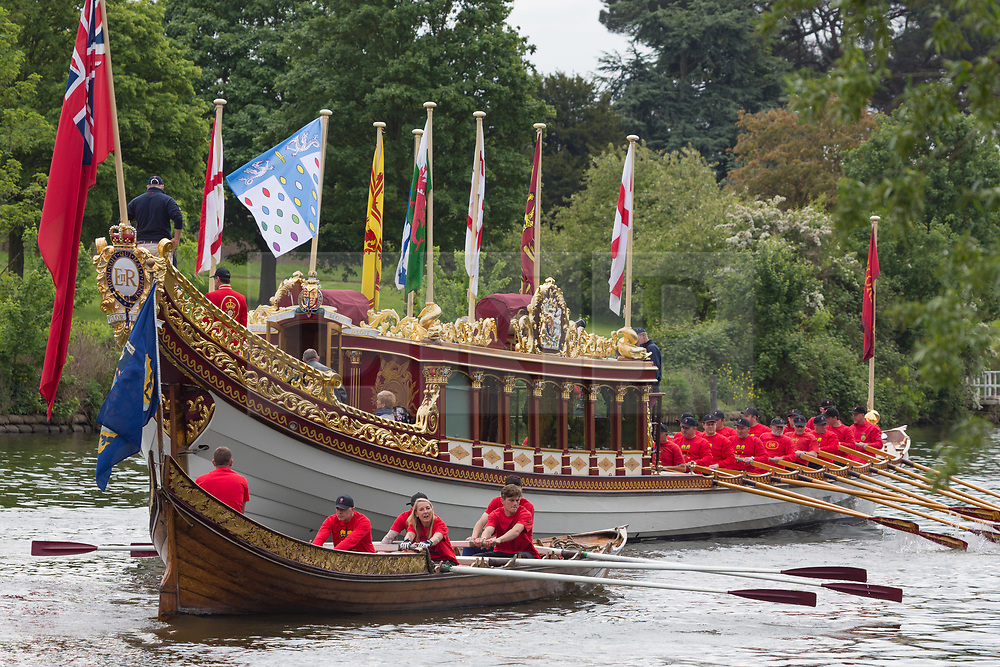 © Licensed to London News Pictures. 13/05/2018. Thames Ditton, UK. Queen's row barge Gloriana pictured on the Thames at Hampton Court as she begins the row all the way to the Tower of London with a small flotilla of traditional Thames craft. The Tudor Pull is an annual event on the river. Photo credit : Rob Powell/LNP
