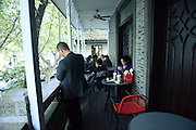 HANGZHOU, CHINA - NOVEMBER 15: (CHINA OUT) <br /> <br /> Chiang Ching-kuos Former Residence Turns Into A McDonalds<br /> <br /> Tourists eat and rest at a McDonalds transformed from house of Chiang Ching-kuos villa near West Lake on November 15, 2015 in Hangzhou, Zhejiang Province of China. Former Taiwan leader Chiang Ching-kuo, son of former Kuomintang leader Chiang Kai-shek, lived with his family in this two-story villa built in 1931 from the end of the War of Resistance against Japanese Aggression (1937-45) until they left for Taiwan in 1949. Two months earlier a Starbucks outlet opened in the side wing of the same house, the report said and now it still open a McDonald's in this historical villa. Controversy goes about in public that the old residence turning into a commercial place would go against the preservation of the historical site<br /> ©Exclusivepix Media
