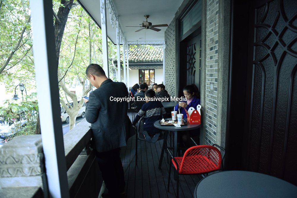 HANGZHOU, CHINA - NOVEMBER 15: (CHINA OUT) <br /> <br /> Chiang Ching-kuos Former Residence Turns Into A McDonalds<br /> <br /> Tourists eat and rest at a McDonalds transformed from house of Chiang Ching-kuos villa near West Lake on November 15, 2015 in Hangzhou, Zhejiang Province of China. Former Taiwan leader Chiang Ching-kuo, son of former Kuomintang leader Chiang Kai-shek, lived with his family in this two-story villa built in 1931 from the end of the War of Resistance against Japanese Aggression (1937-45) until they left for Taiwan in 1949. Two months earlier a Starbucks outlet opened in the side wing of the same house, the report said and now it still open a McDonald's in this historical villa. Controversy goes about in public that the old residence turning into a commercial place would go against the preservation of the historical site<br /> &copy;Exclusivepix Media
