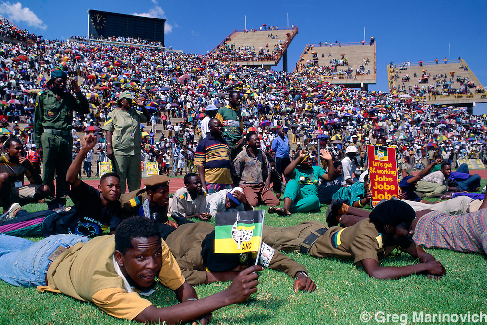 Mmbatho, Bophuthatswana, South Africa 1994. Massive crowds attend a rally addressed by Nelson Mandela during his pre election campaign. The ANC won with a large majority in South Africa's first democratic elections.