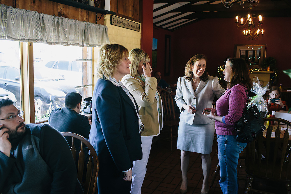 West Virginia Secretary of State Natalie Tennant, center, talks with guests, including Beth Dolan, executive director of Hardy County Convention and Visitor's Bureau, right, at O'Neill's Diner in Moorefield, W.V. on Wednesday, April 16, 2014. Tennant is running for a US Senate seat in West Virginia against Republican Rep. Shelley Moore Capito.