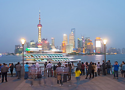 Evening view of skyline of Pudong financial district from The Bund in Shanghai China