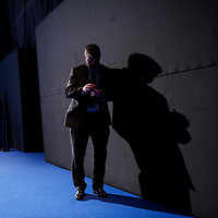 A delegate works his mobile phone during the Conservatives Party Conference at Manchester Central.