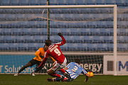 Walsall forward Tom Bradshaw  beats Coventry City defender Chris Stokes  but fails to beat Coventry City goalkeeper Reice Charles-Cook during the Sky Bet League 1 match between Coventry City and Walsall at the Ricoh Arena, Coventry, England on 12 January 2016. Photo by Simon Davies.