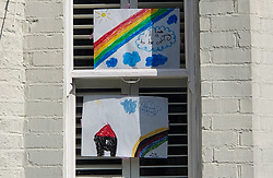 © Licensed to London News Pictures. 28/03/2020. London, UK. Hand painted pictures of colourful rainbows are displayed in a window of a house in north London. Rainbows are used as a symbol of peace and hope. Photo credit: Dinendra Haria/LNP