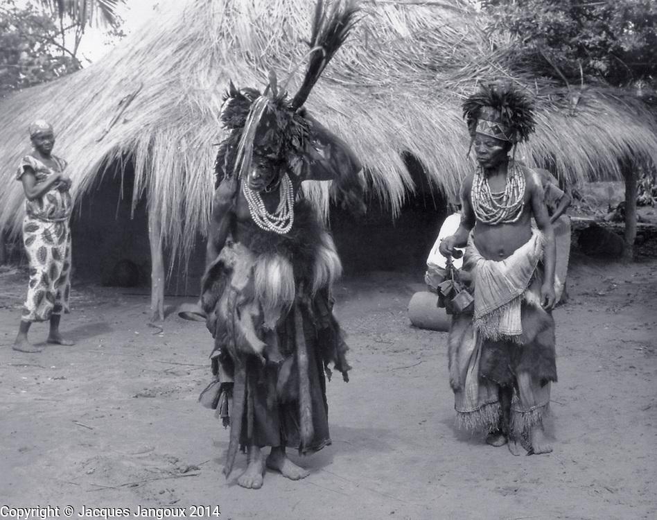 Luba traditional diviners (medicine men) dancing to he sound of slit drum, Kaluanzo, Katanga Province, then Belgian Congo, now Democratic Republic of the Congo (1959)