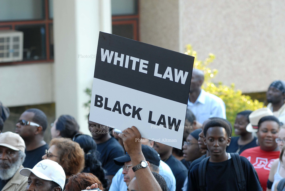 Supporters of the so-called Jena Six gather in front of the LaSalle Parish Courthouse in Jena, Louisiana, U.S., on Thursday, Sept. 20, 2007. Thousands of people gathered to support the black teenagers who had been charged with attempted murder in the beating of a white classmate.(photo/Suzi Altman)